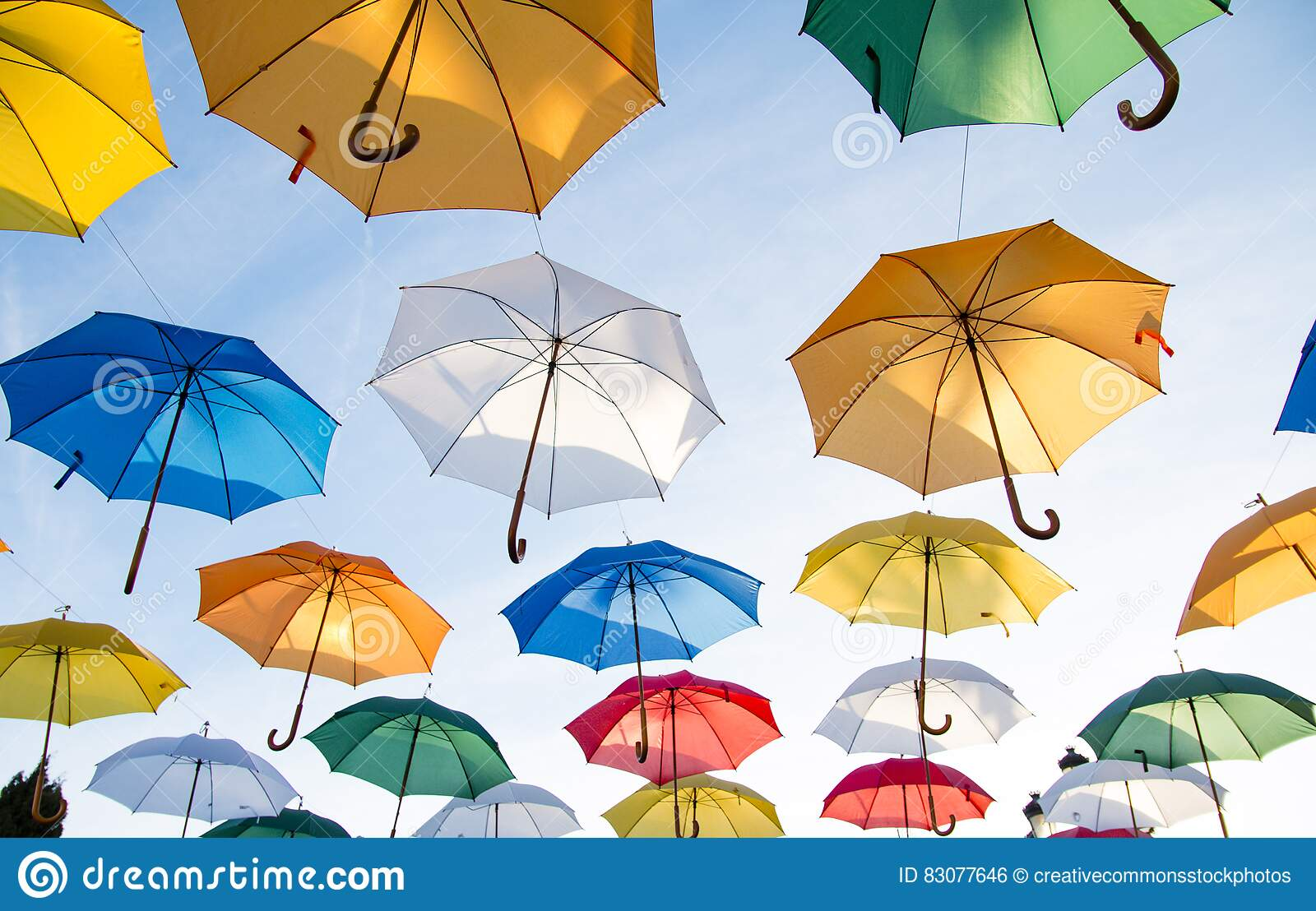 Colorful umbrellas flying in sky