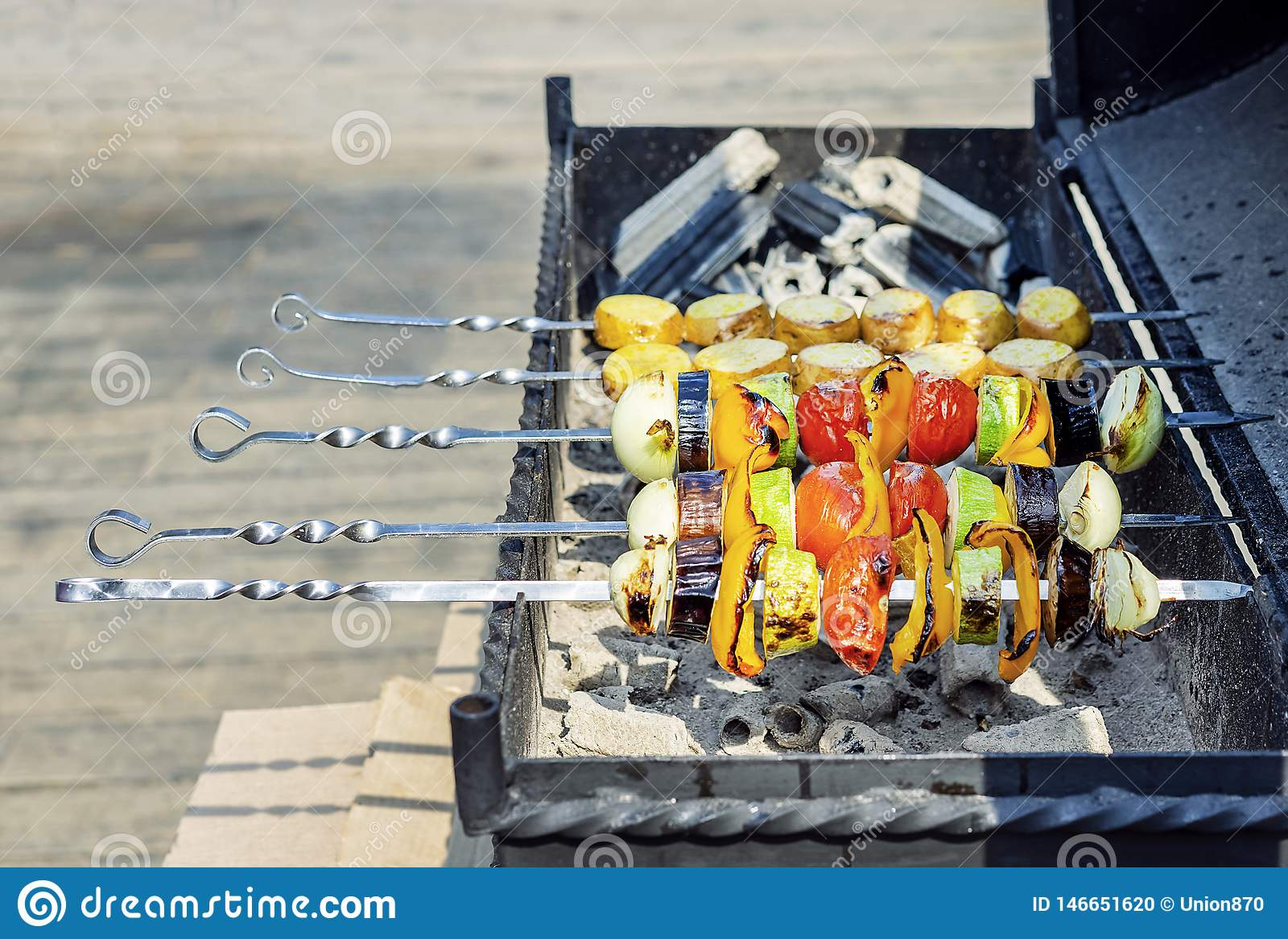Colorful vegetarian vegetable skewers with roasted bell peppers, onions, eggplants, tomatoes and zucchini