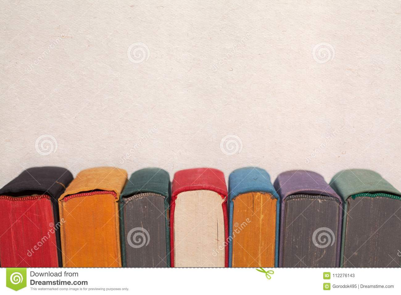 Colorful Vintage Books On Aged Textured Paper Background Covers