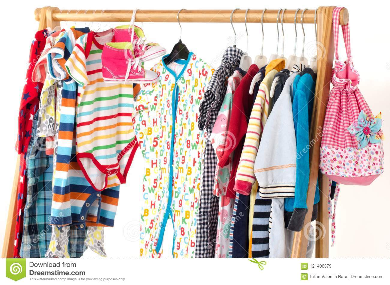 697602c11 Dressing Closet With Kids Clothes Arranged On Hangers. Stock Image ...