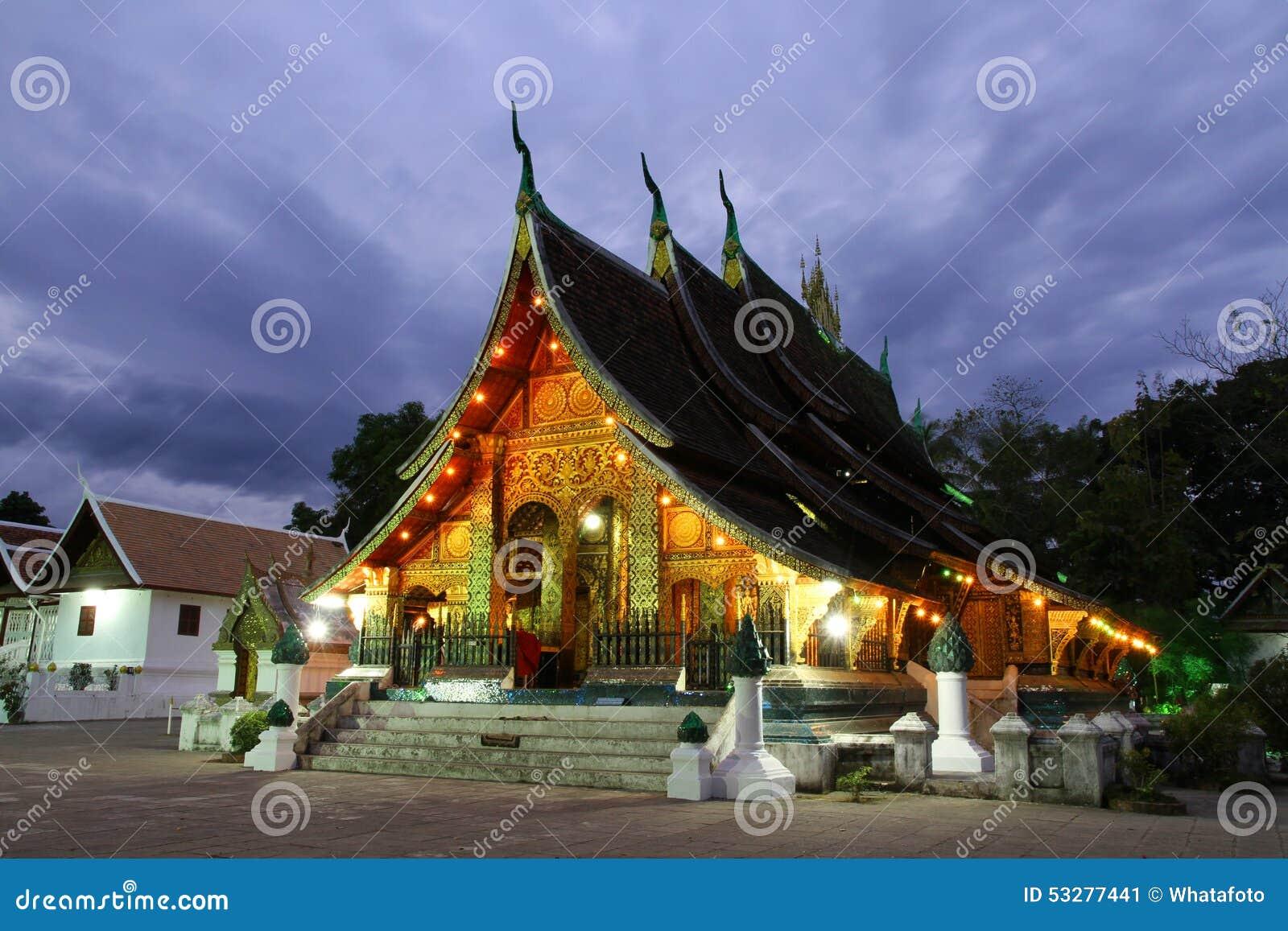 Colorful Wat Xieng thong temple at dusk in Luang Prabang, Loas