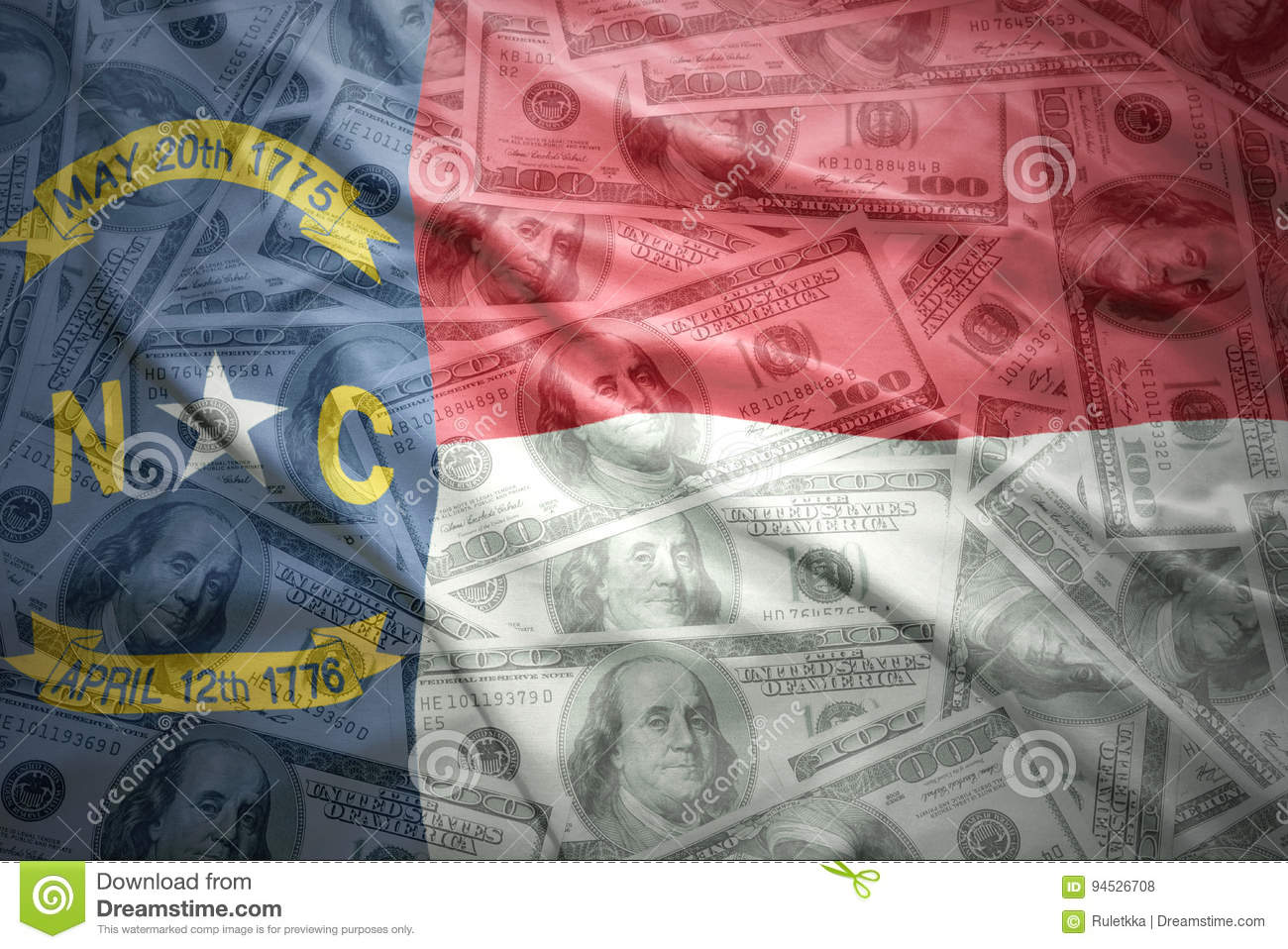 Colorful waving north carolina state flag on a american dollar money background
