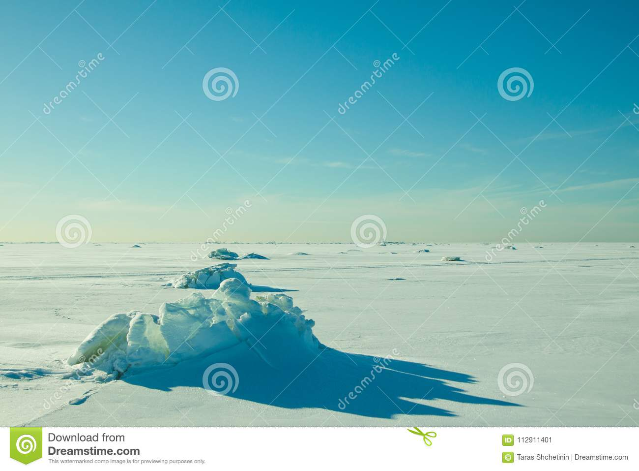Colorful winter view over the deserted surface with cracked crystal ice which looks like snow volcano.