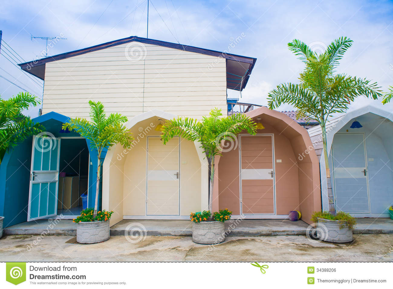Colorful wooden house and green tree royalty free stock for Colorful tree house