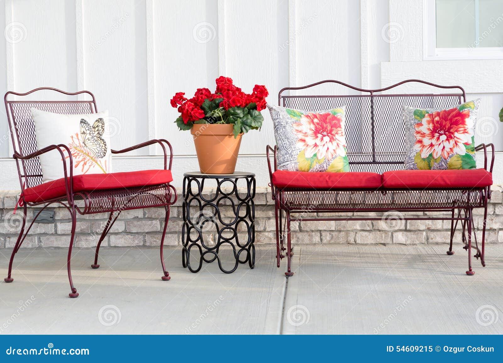 Colorful wrought iron garden furniture stock image image - Cojines para sofas de jardin ...
