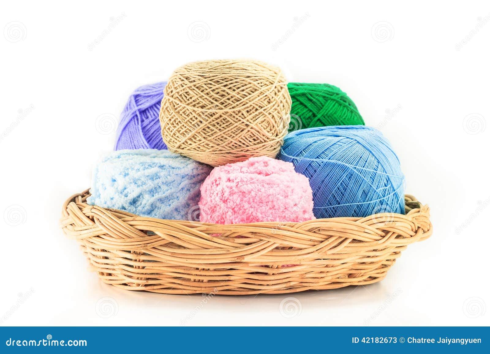 Colorful yarn in wicker basket
