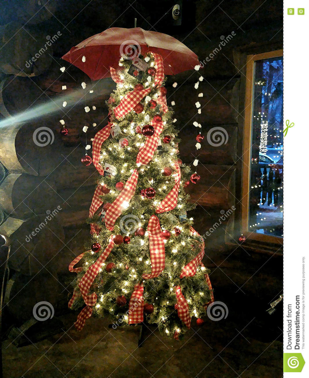 colorfully decorated christmas tree with umbrella and string lights hanging from the top - How To String Lights On A Christmas Tree