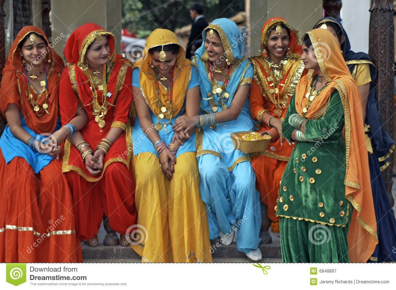 Group of colorfully dressed Indian ladies at the annual Surajkund Mela ...