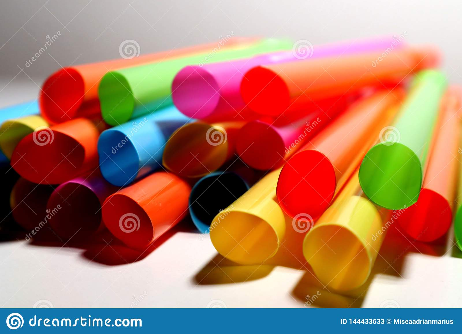 Coloured king size straws piled together