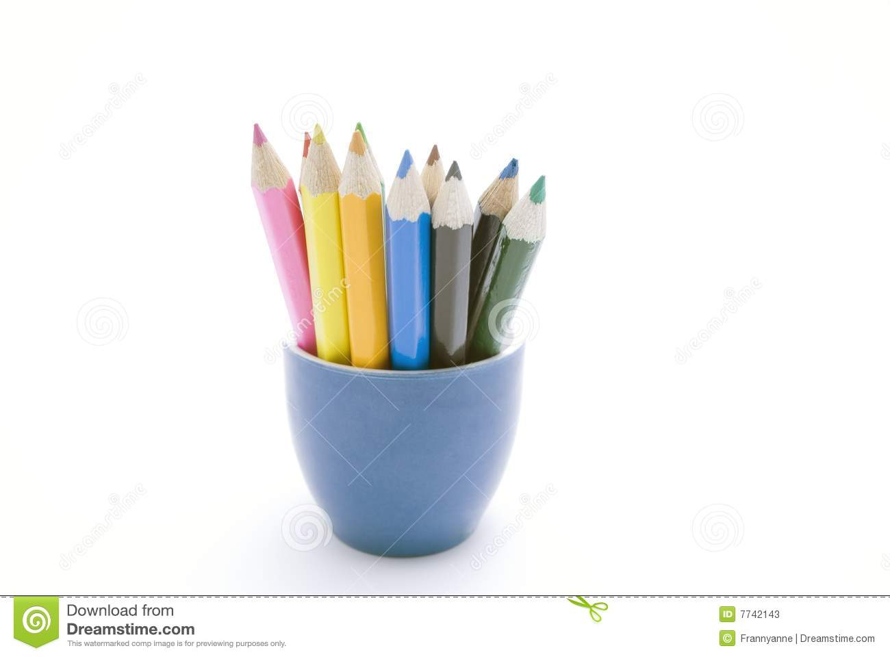pencils in a blue ceramic container against a white background. Pencil ...