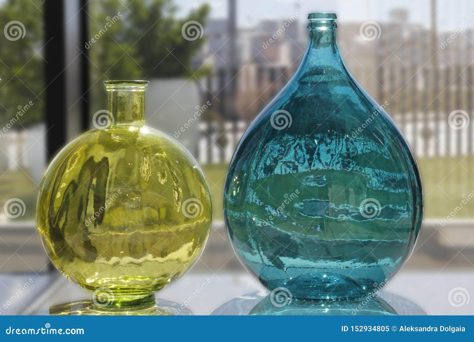 Coloured transparent boottles