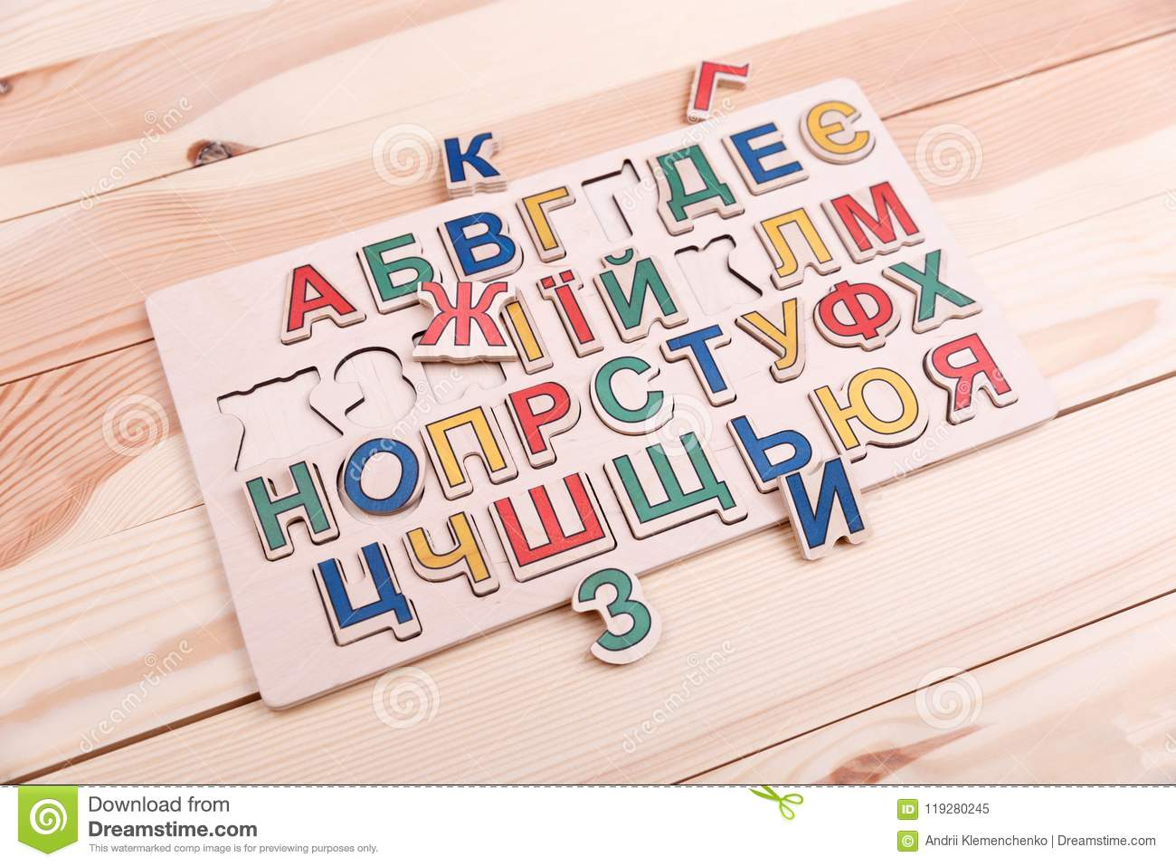 A Colourful Alphabet With Letters Is Situated On The Wooden Background Every Letter Of Different Colour