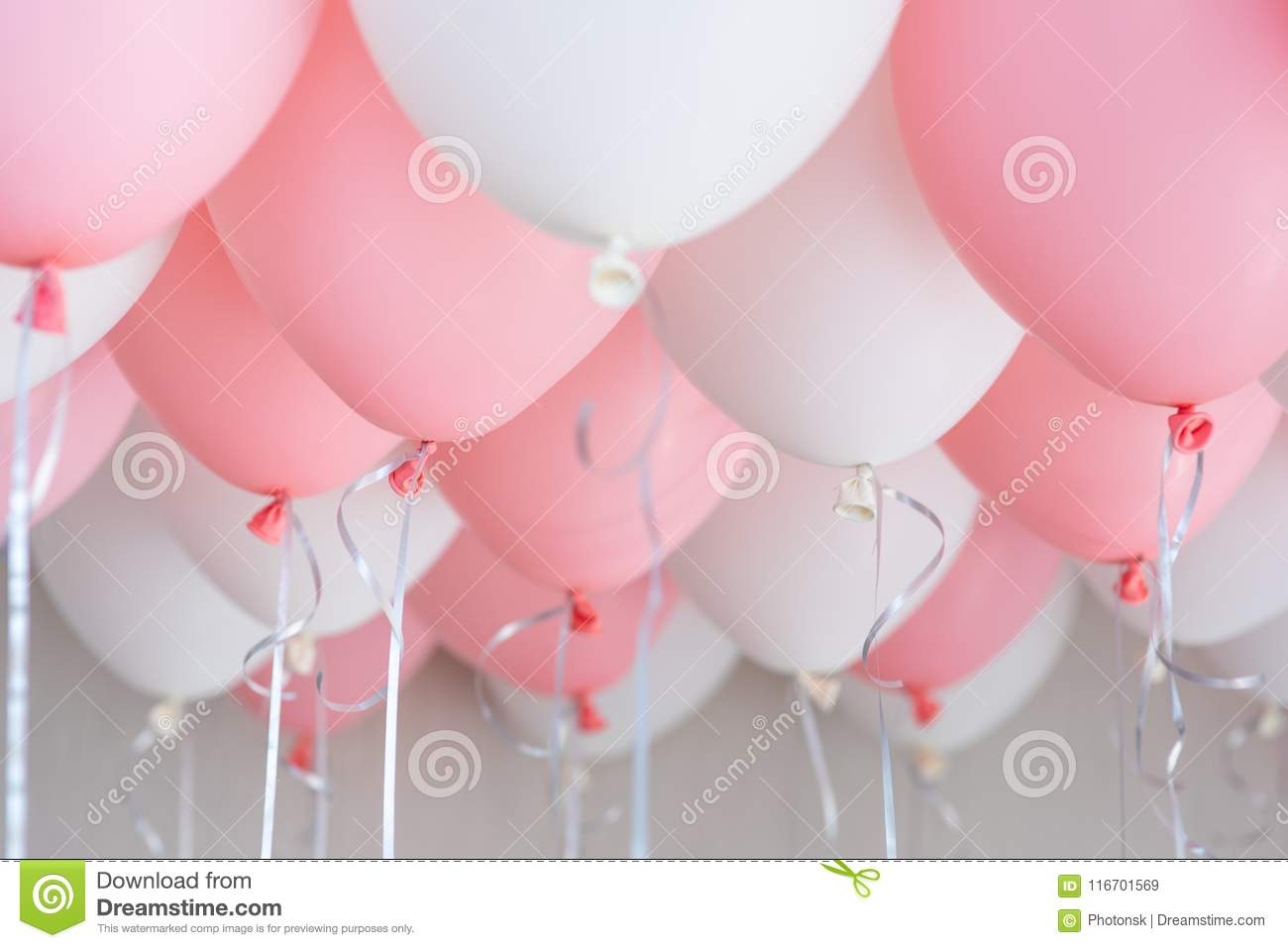 Colourful balloons, pink, white, streamers. Helium Ballon floating in birthday party. Concept balloon of love and
