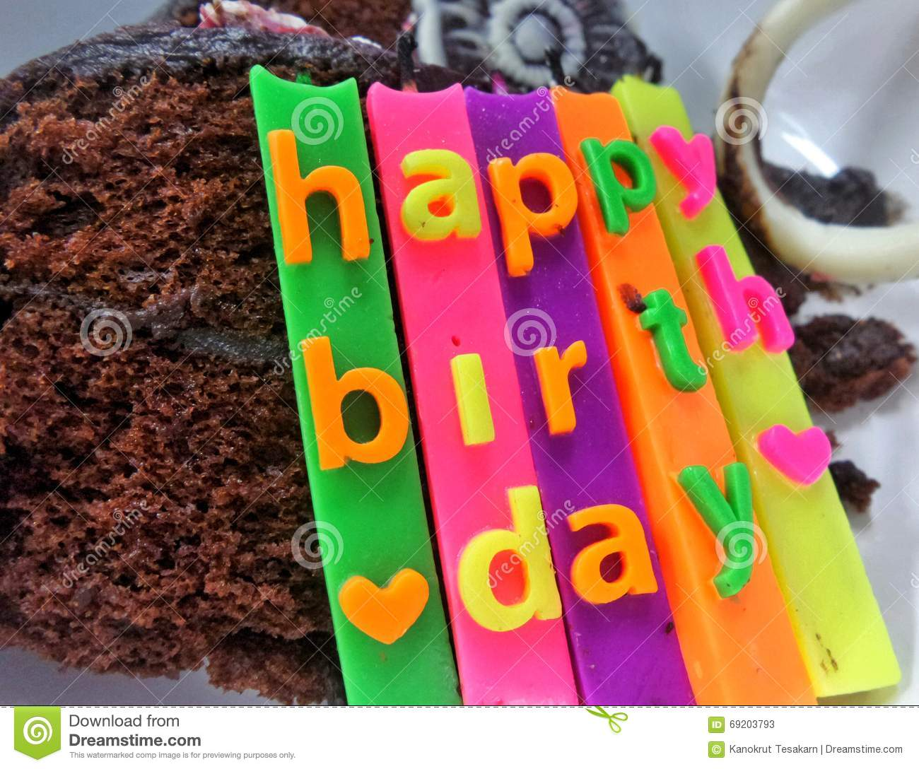 ... cerebration candles on Chocolate cake and biscuit on white background