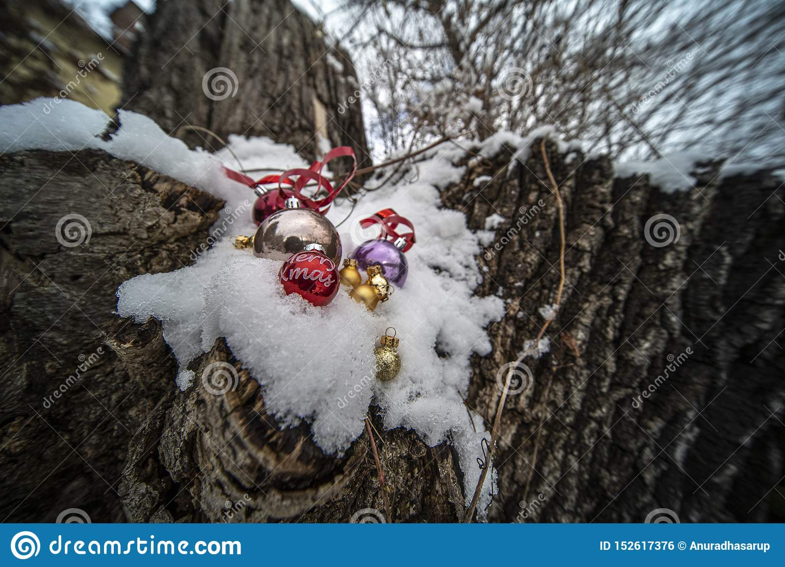 Christmas ornaments in snow