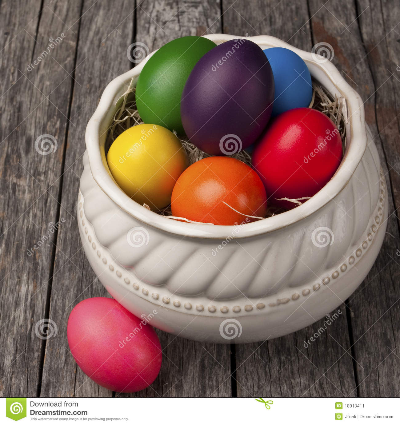 Colourful Easter eggs on wood