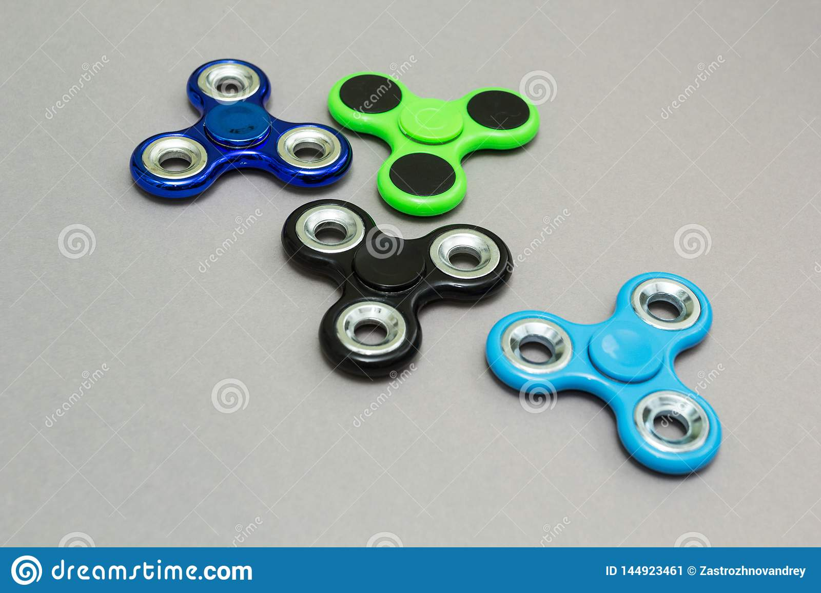 Colourful fidget finger spinner stress on grey background