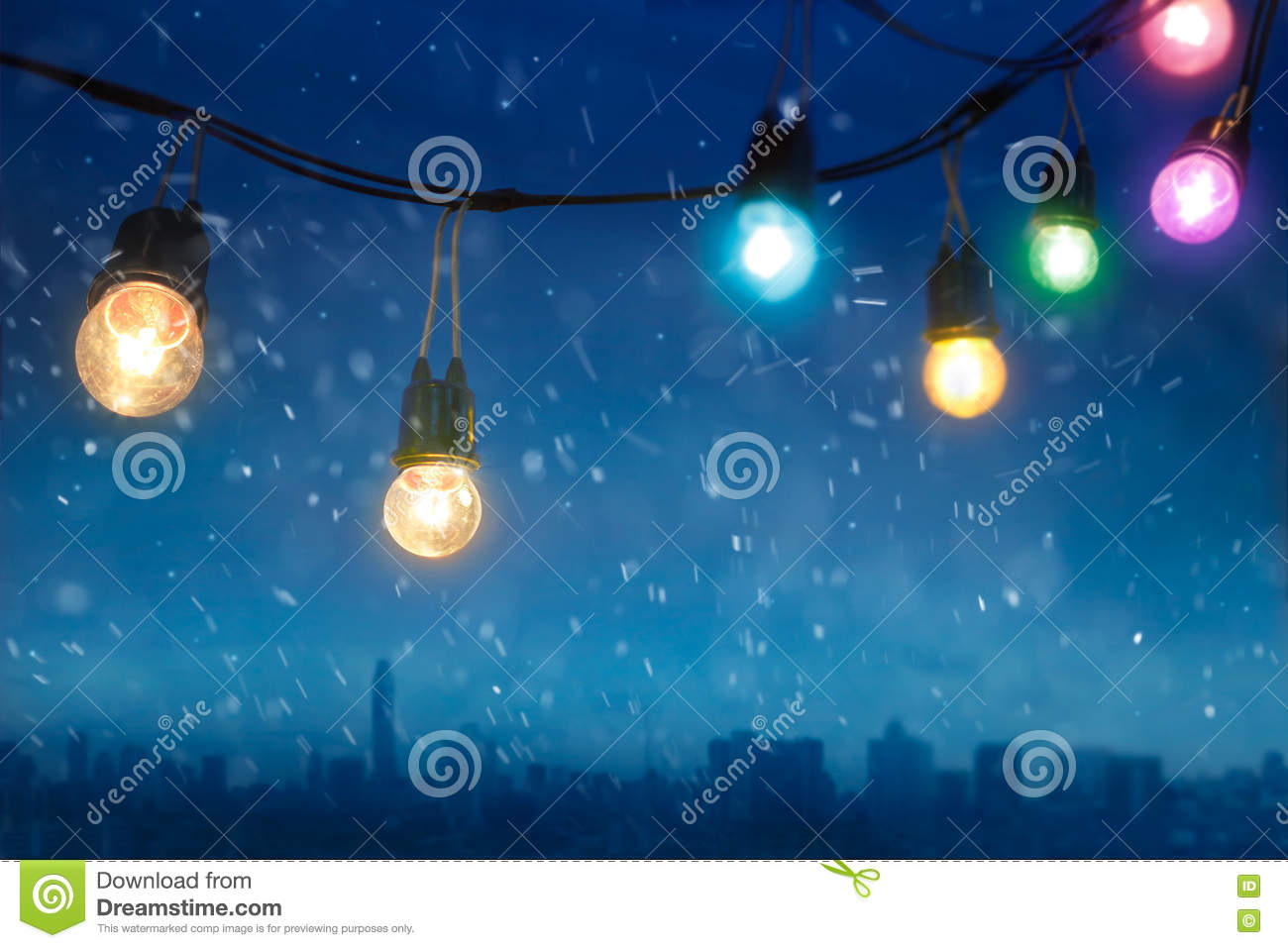 Colourful Glowing Christmas Lights In Snowfall On The Dark Blue City ...