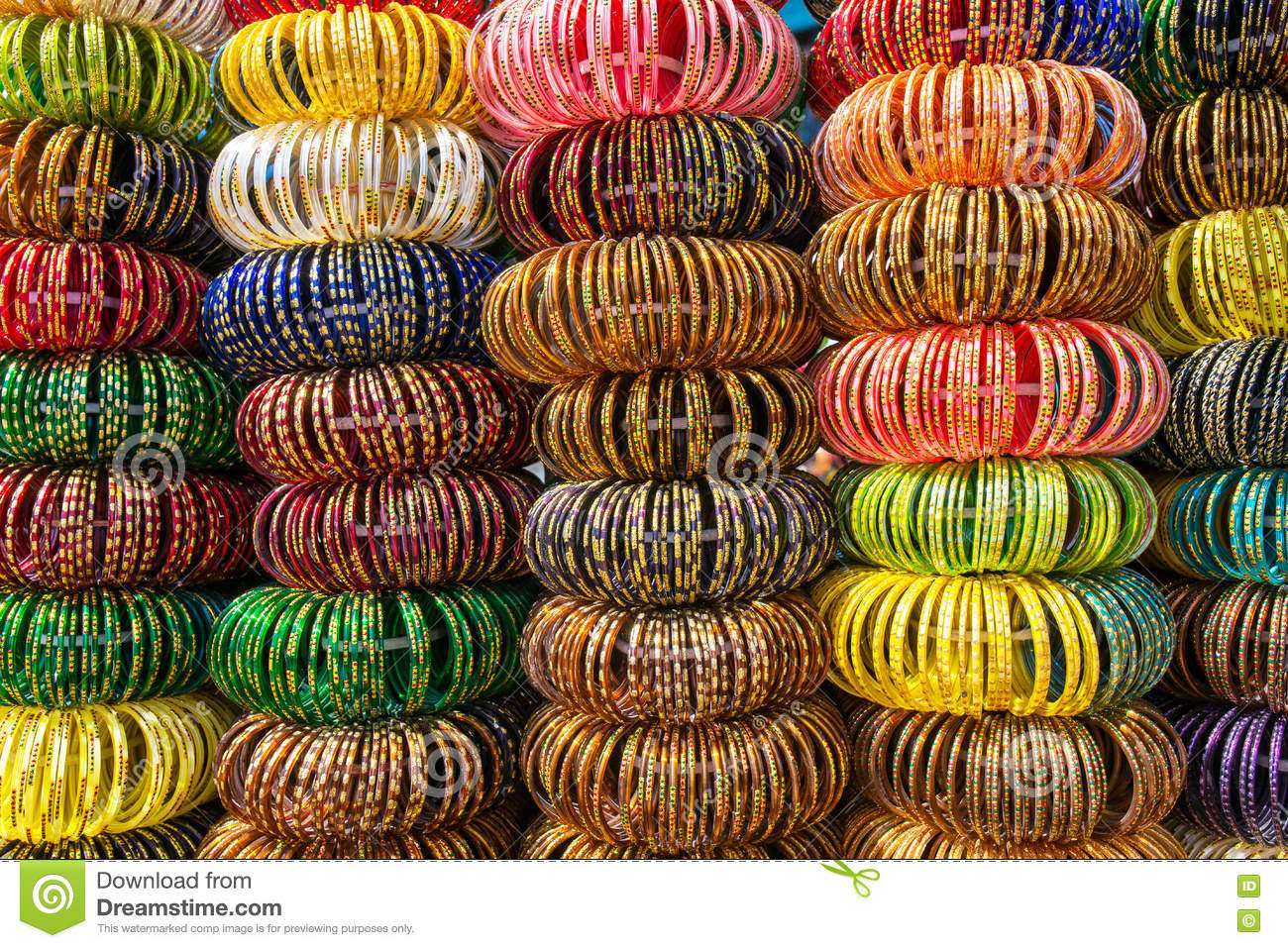 Colourful Indian wrist bracelets stacked in piles