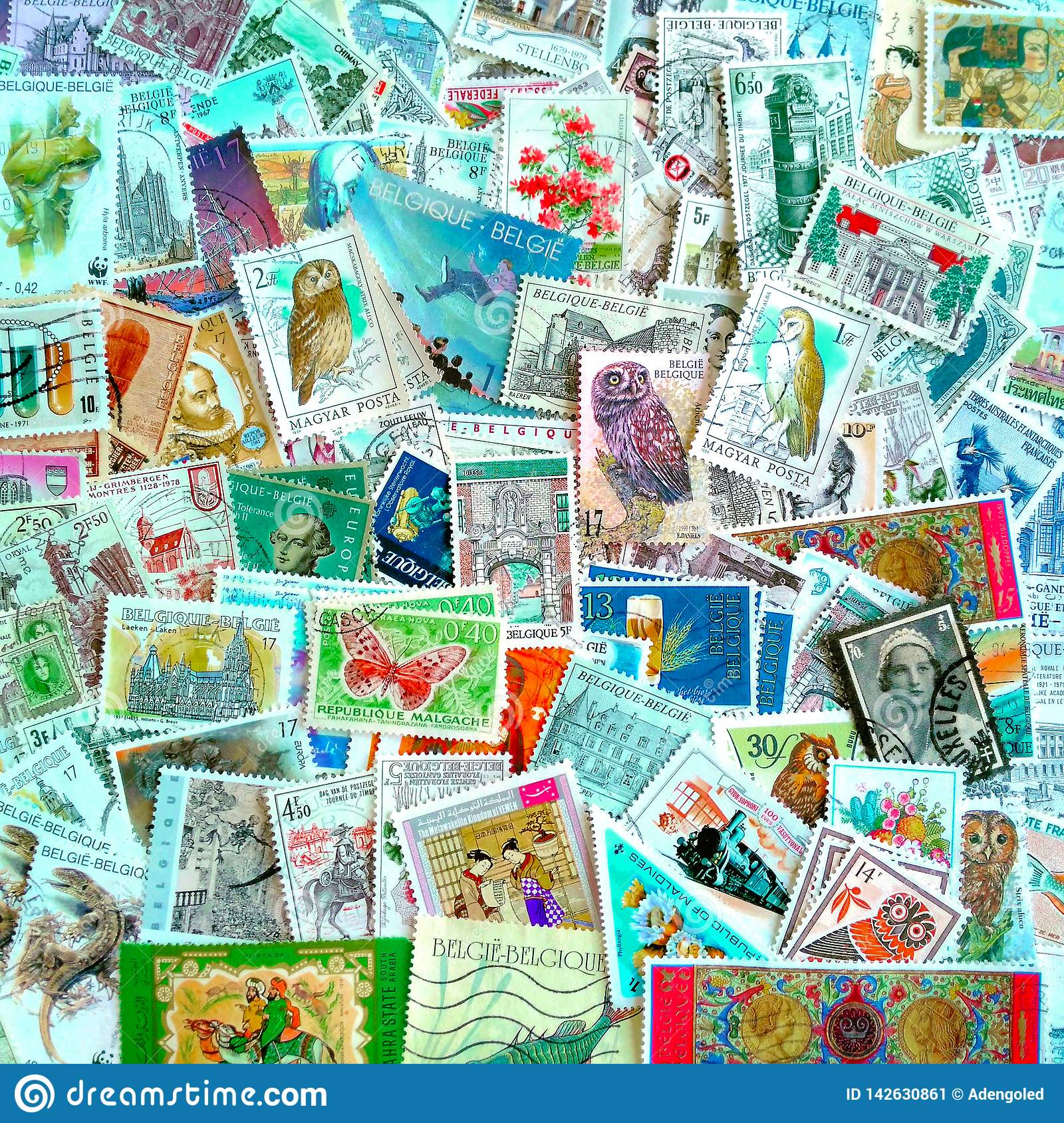 A colourful mix of mostly Belgian used postage stamps on various themes