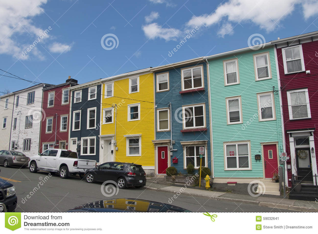 Colourful salt box homes in the quidi vidi district of st for Newfoundland houses