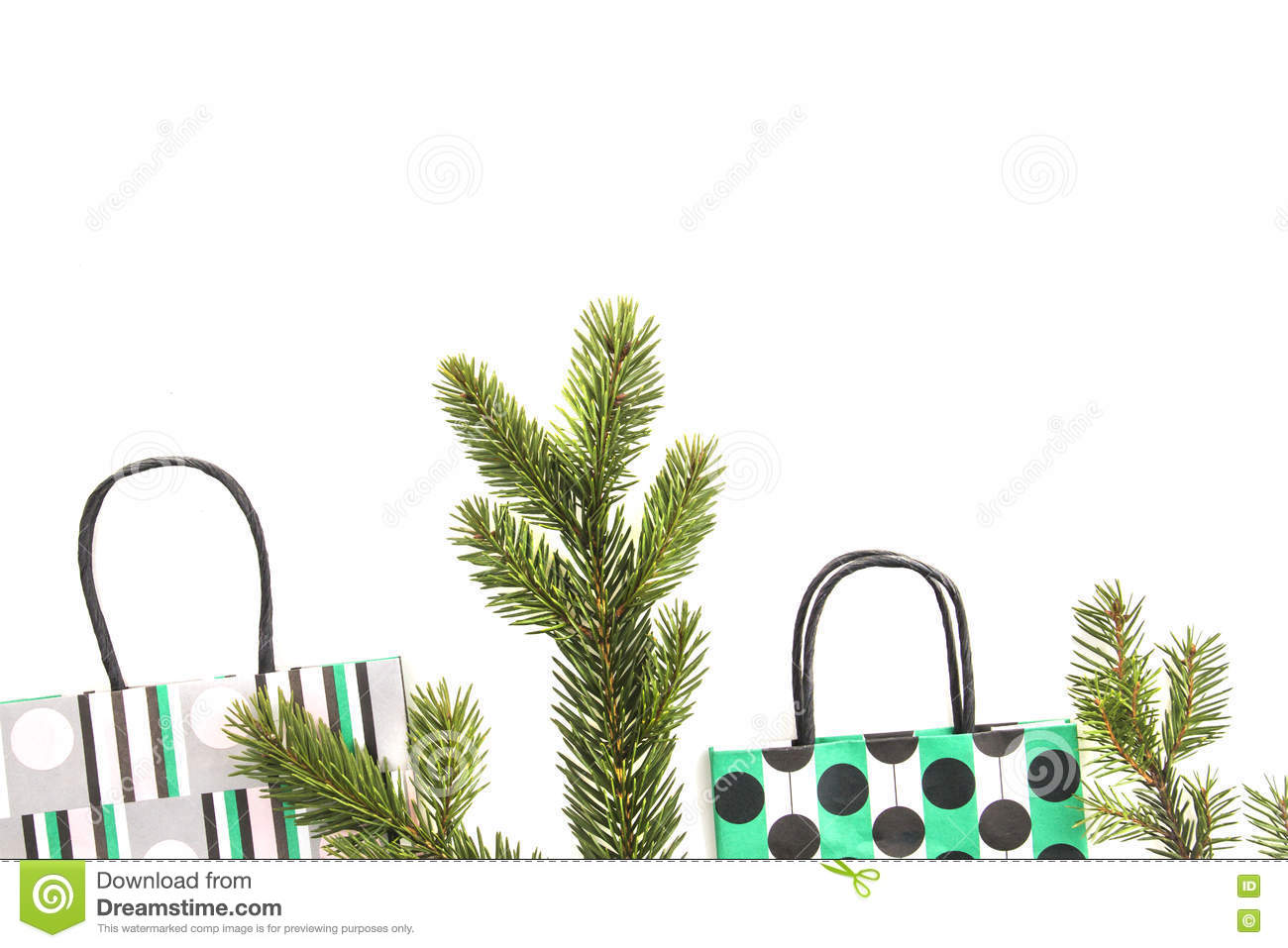 Colourful Shopping Bags And Fir Tree Branch On White Background ...