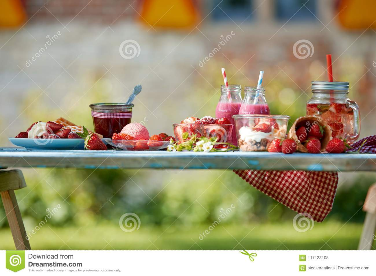 Colourful summer strawberries desserts picnic table