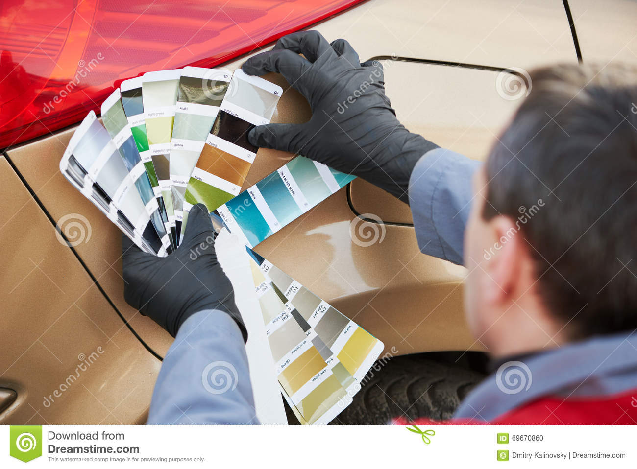 Colourist Man Selecting Color Of Car With Paint Matching Samples ...