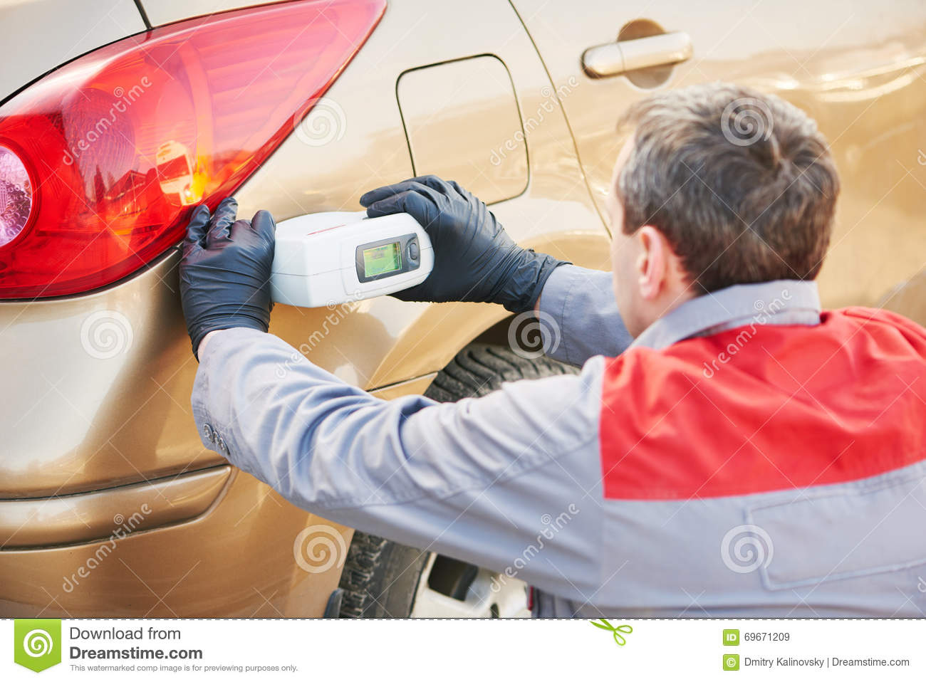 Car paint colour - Colourist Man Selecting Color Of Car With Paint Matching Scanner Royalty Free Stock Images