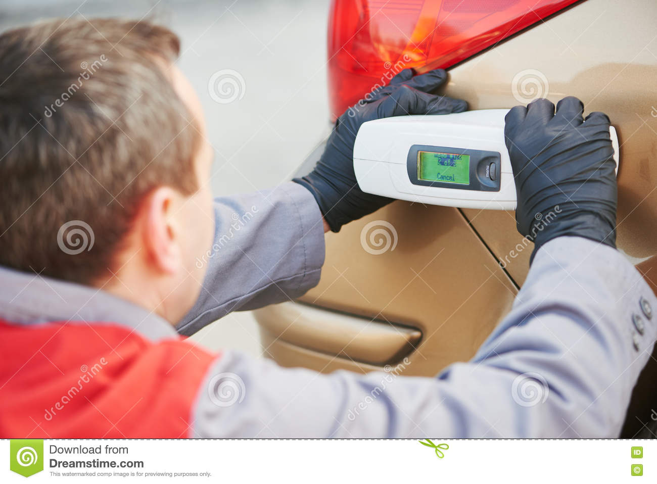 Colourist Man Selecting Color Of Car With Paint Matching Scanner ...