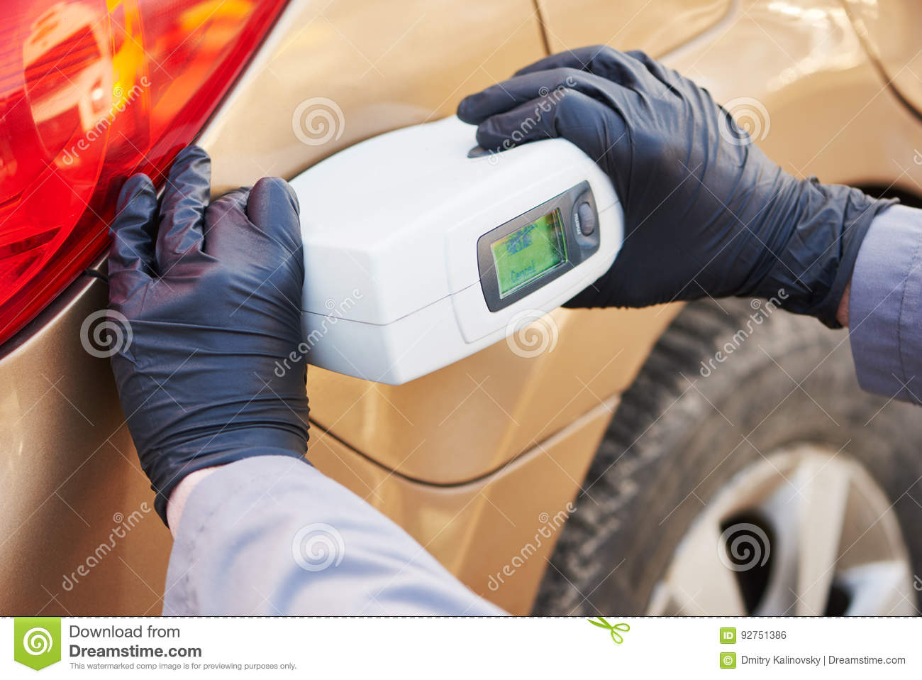 Car Color Paint Match - Colourist man selecting color of car with paint matching scanner stock photo