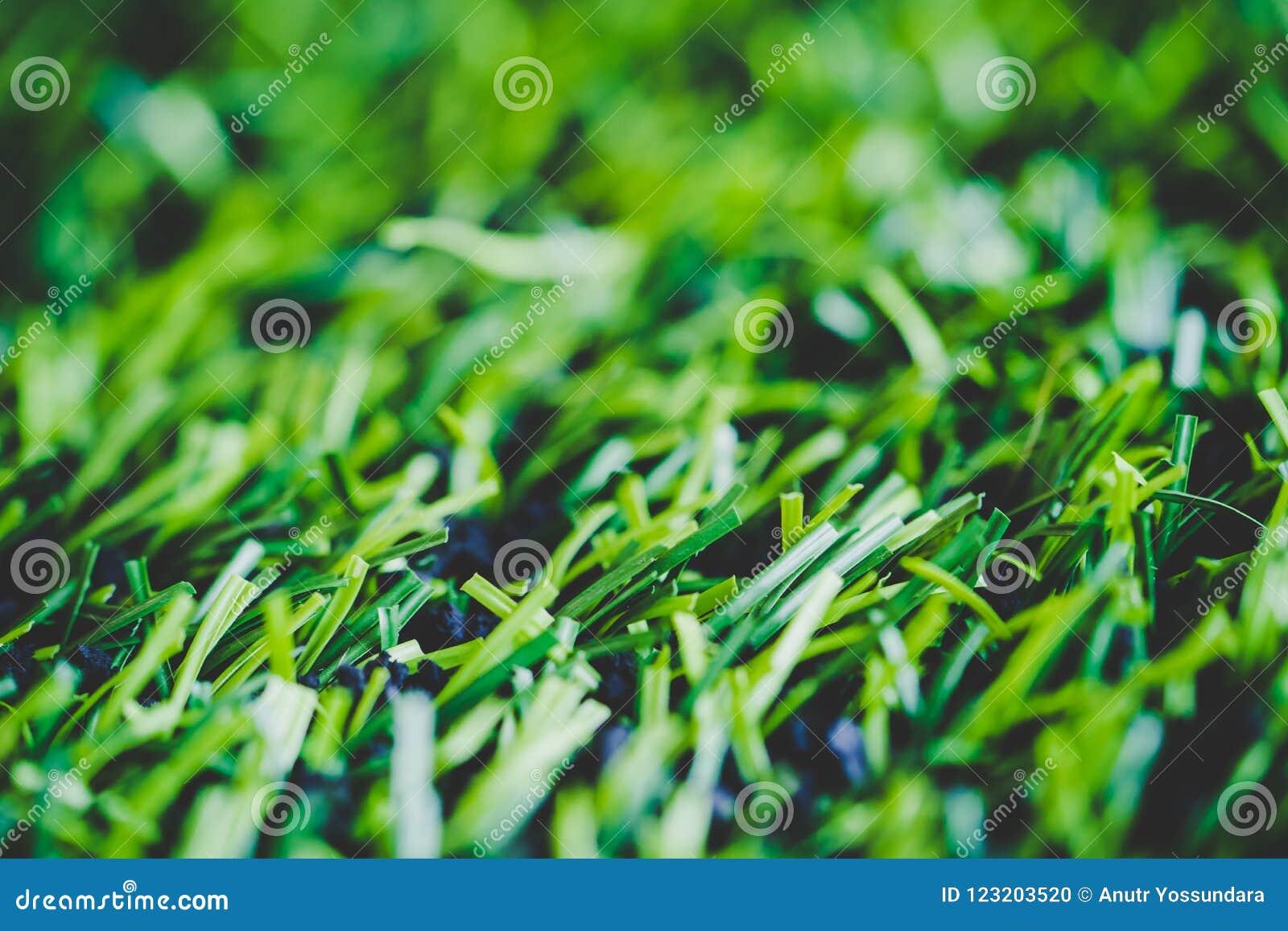 Colpo alto chiuso dell erba del manufatto per il campo di sport dell interno