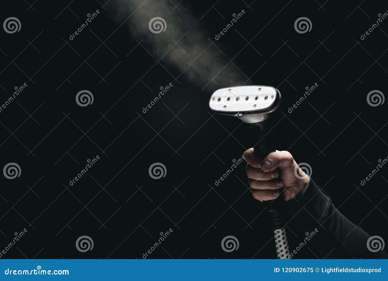 Colpo potato del vapore dell indumento della tenuta della persona con vapore