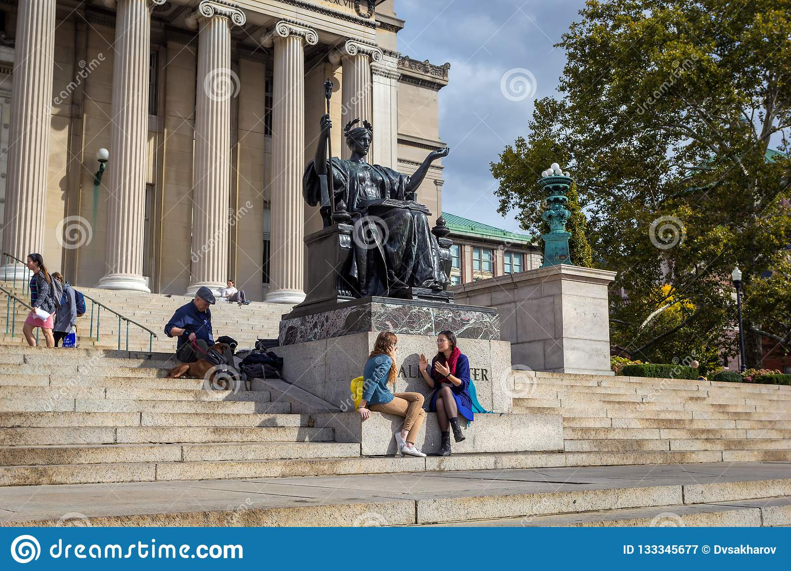 Columbia University Library buildings with columns and Alma Mater statue