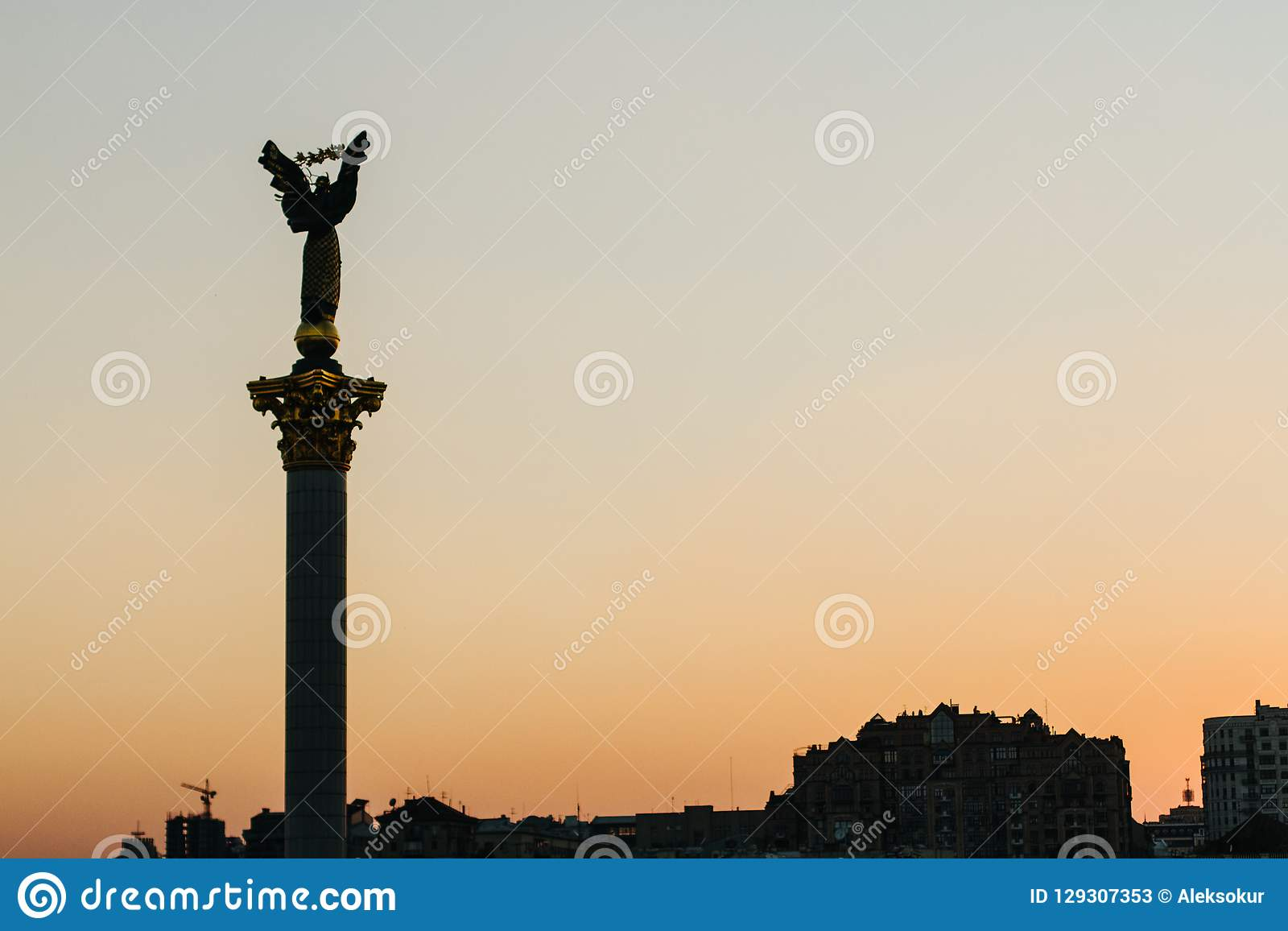 Column of independent with sunset