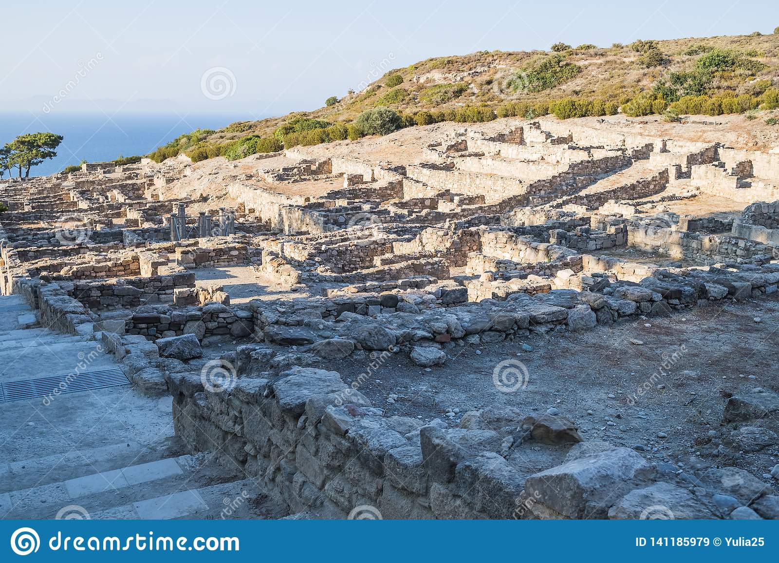 Columns of doric temple in city of Kamiros.Hellenistic houses in ancient city of Kamiros ,island of Rhodes, Greece