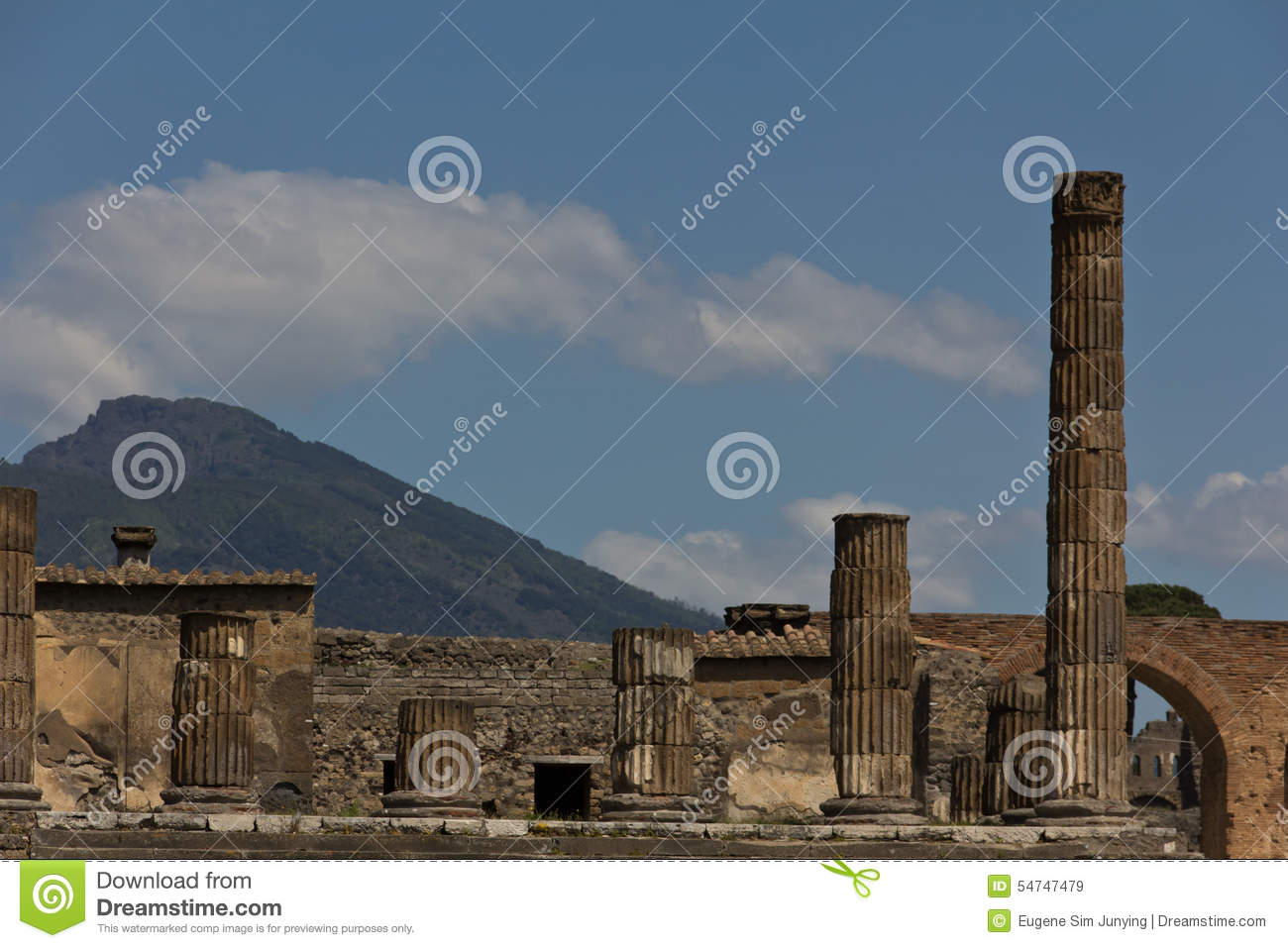 Columns from the excavated forum of Pompeii with Mount Vesuvius