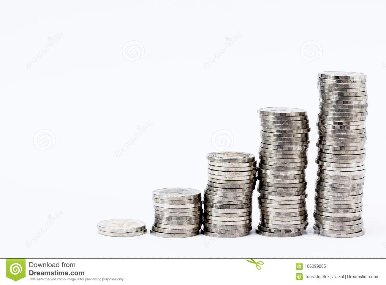 Columns Of Stacked Coins On The White Background Stock Image