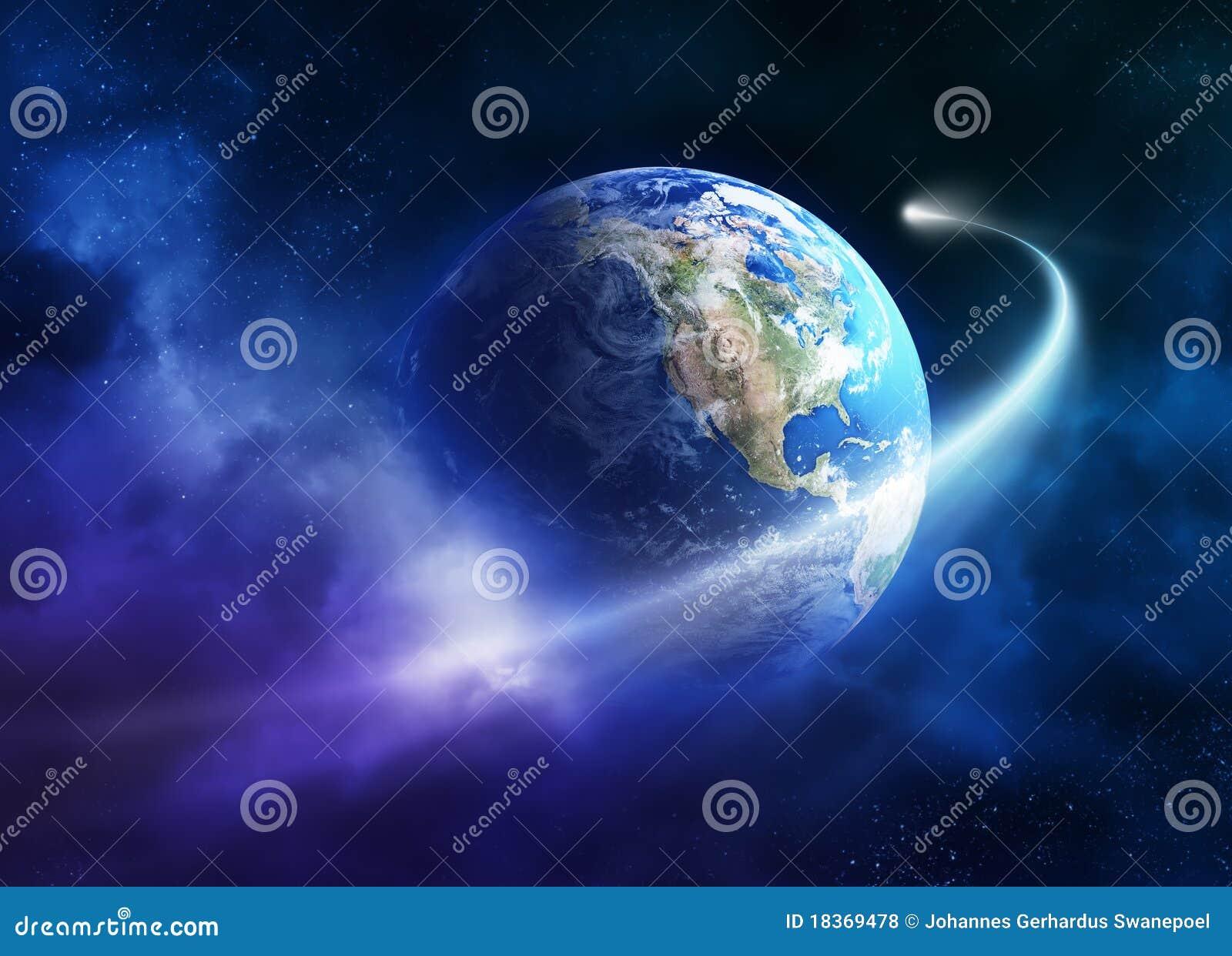 Comète déménageant passant la terre de planète
