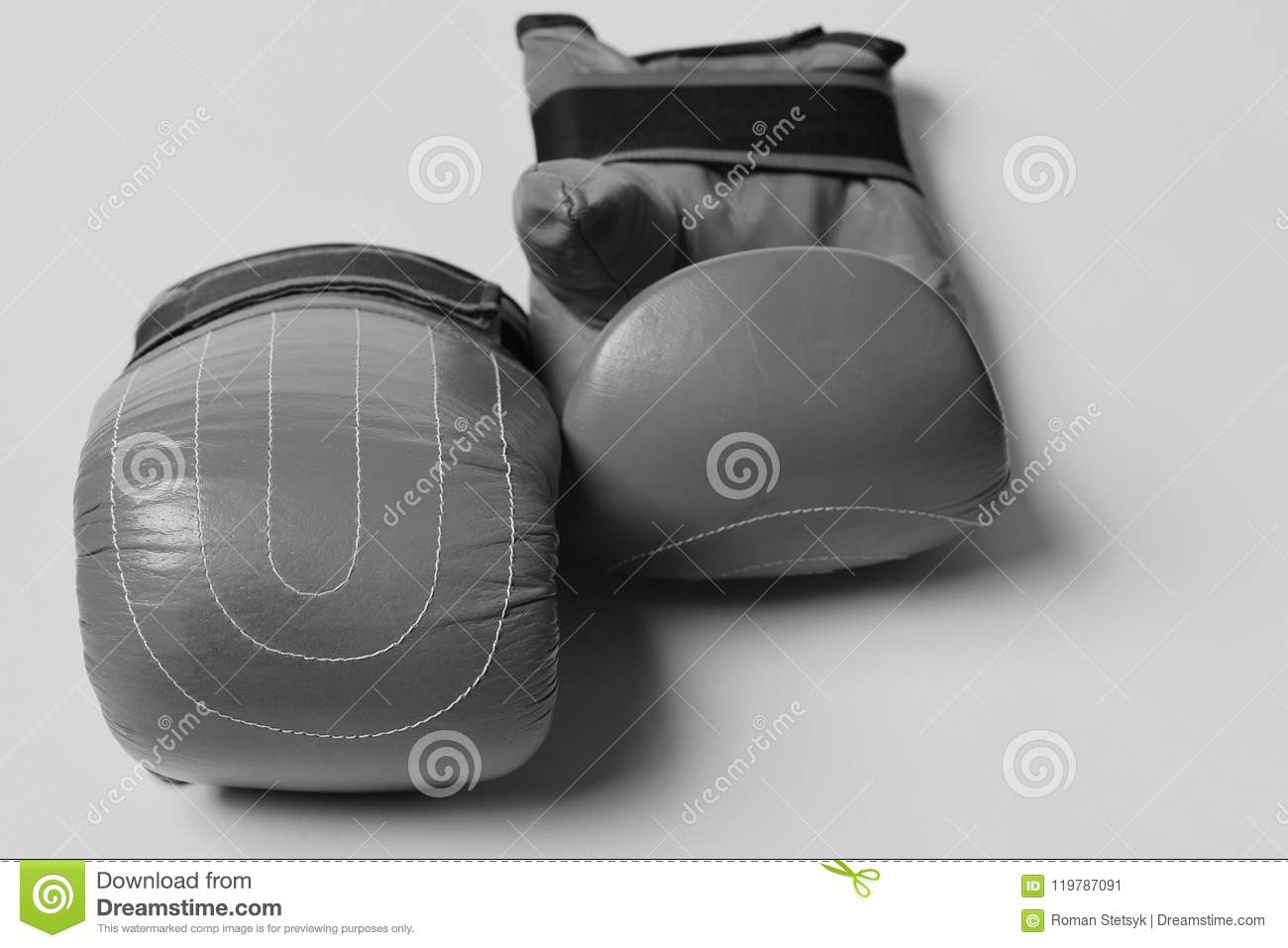 Combat and fight concept. Pair of boxing gloves lying next to each other.