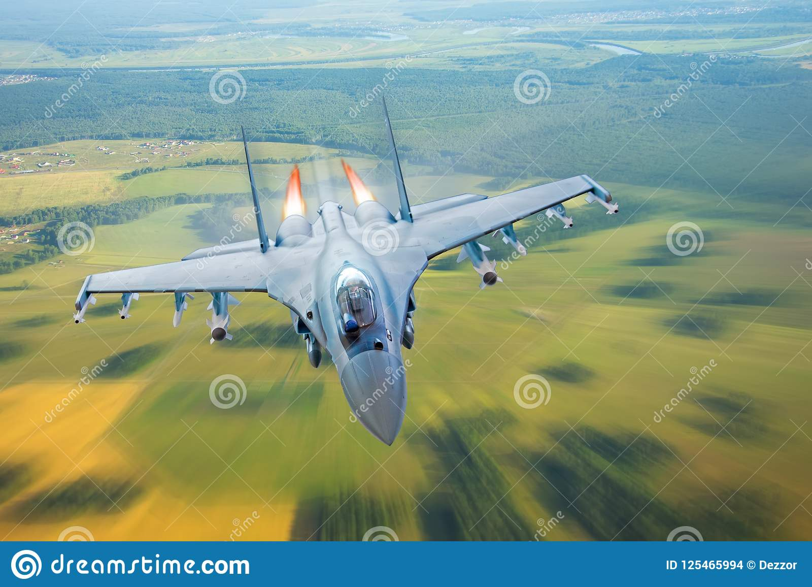 Combat fighter jet on a military mission with weapons - rockets, bombs, weapons on wings, at high speed with fire afterburner engi