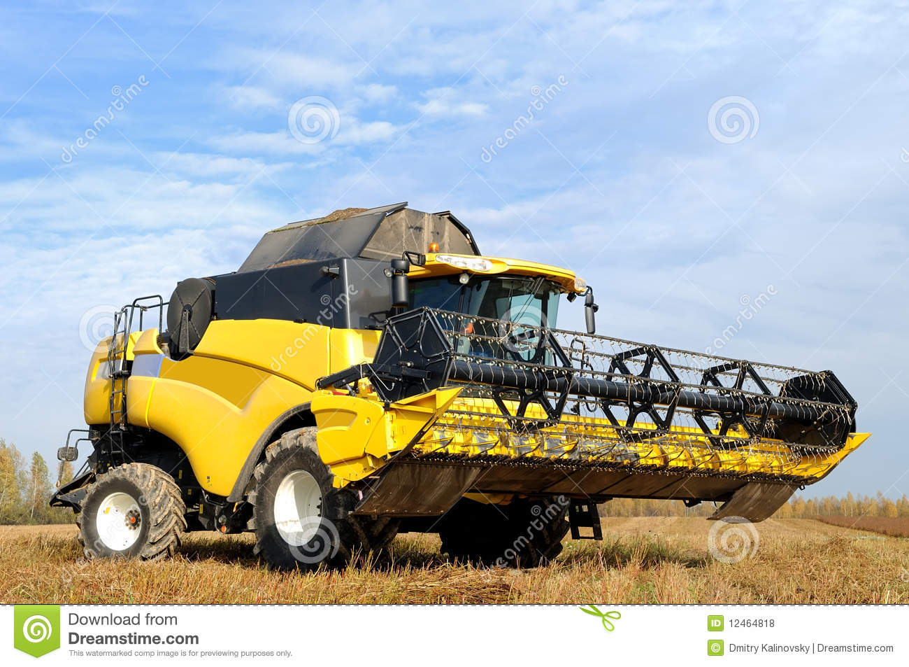 Combine Harvester In The Field Stock Photo