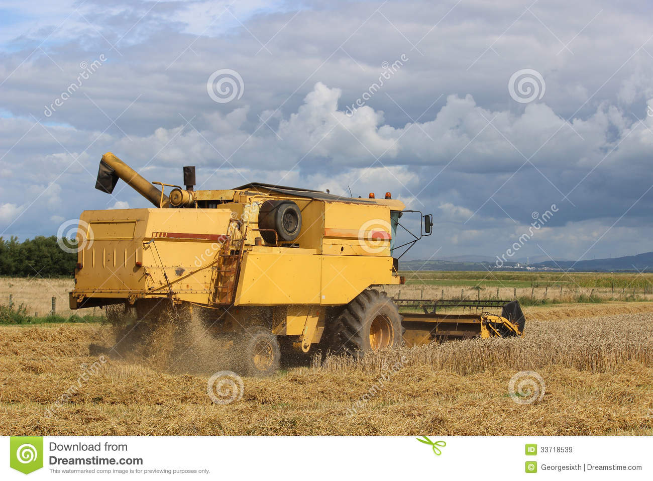 Combine Harvester At Work In Cereal Field. Stock Image ...