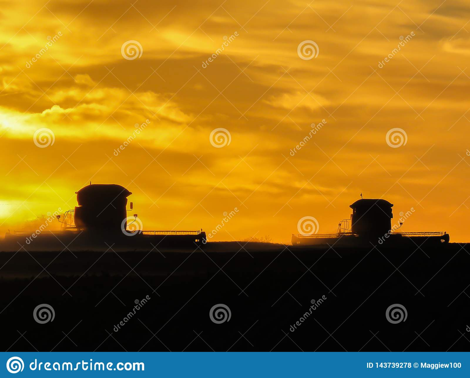 Combines in the sunset
