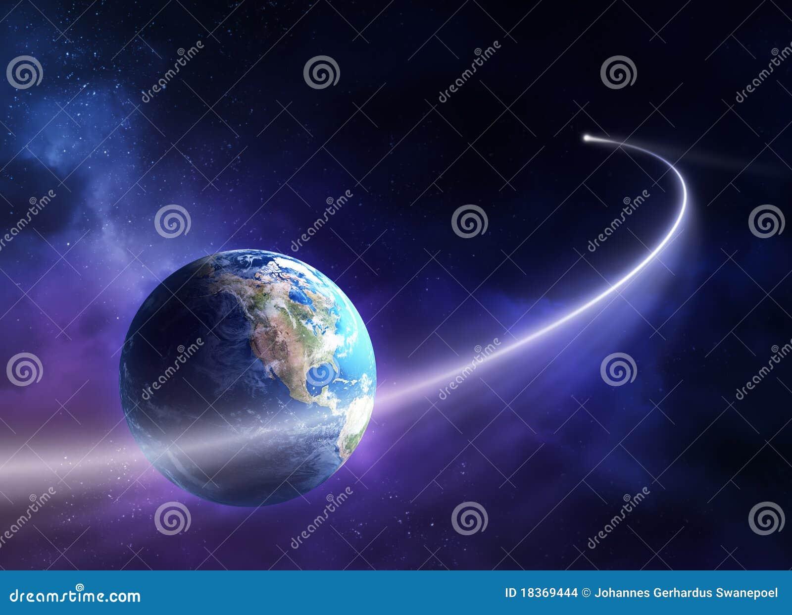 Cometa que pasa la tierra del planeta