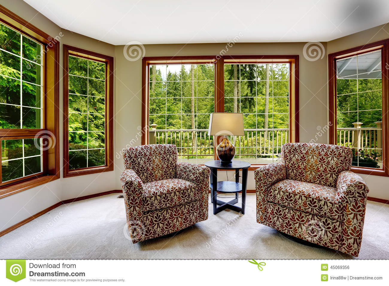 Comfort Sitting Area With Large French Windows Stock Photo