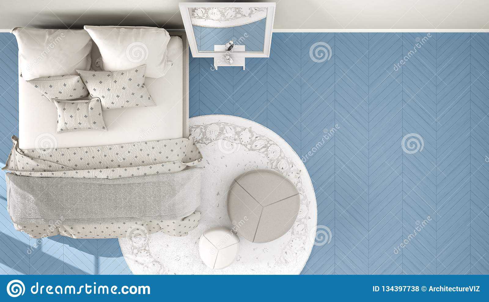 Comfortabele moderne blauwe en beige slaapkamer met houten parketvloer, tapijt met poef en bed met minimale deken en hoofdkussens