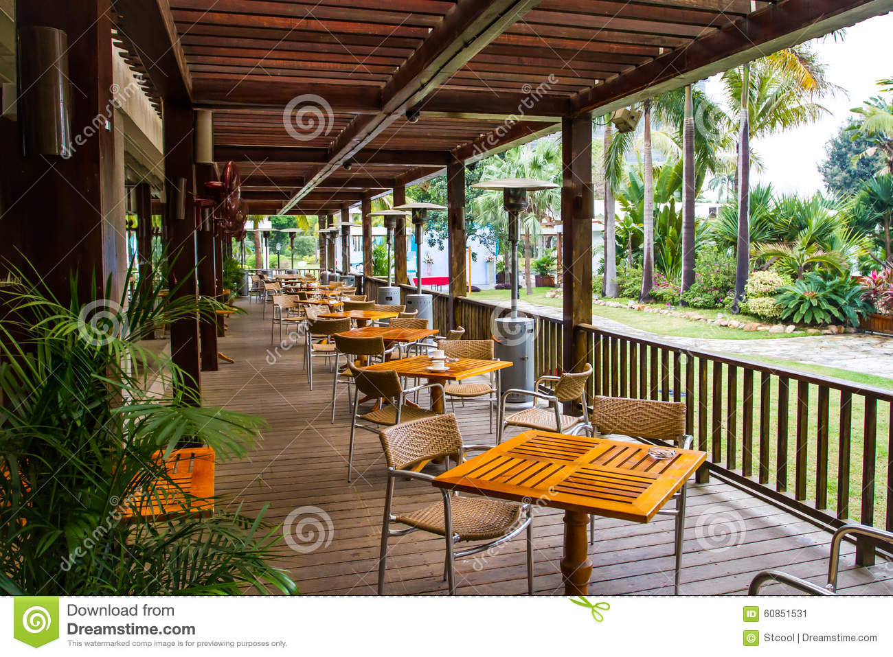 Comfortable balcony dining area stock image image 60851531 for Comfy hotels resorts