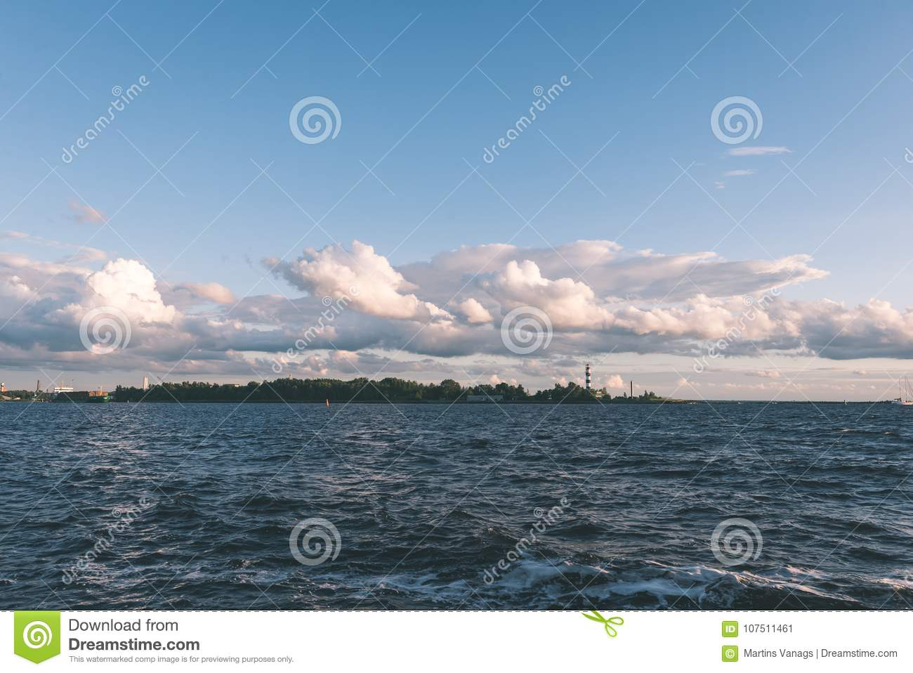 comfortable beach of the baltic sea with rocks and green vegetat