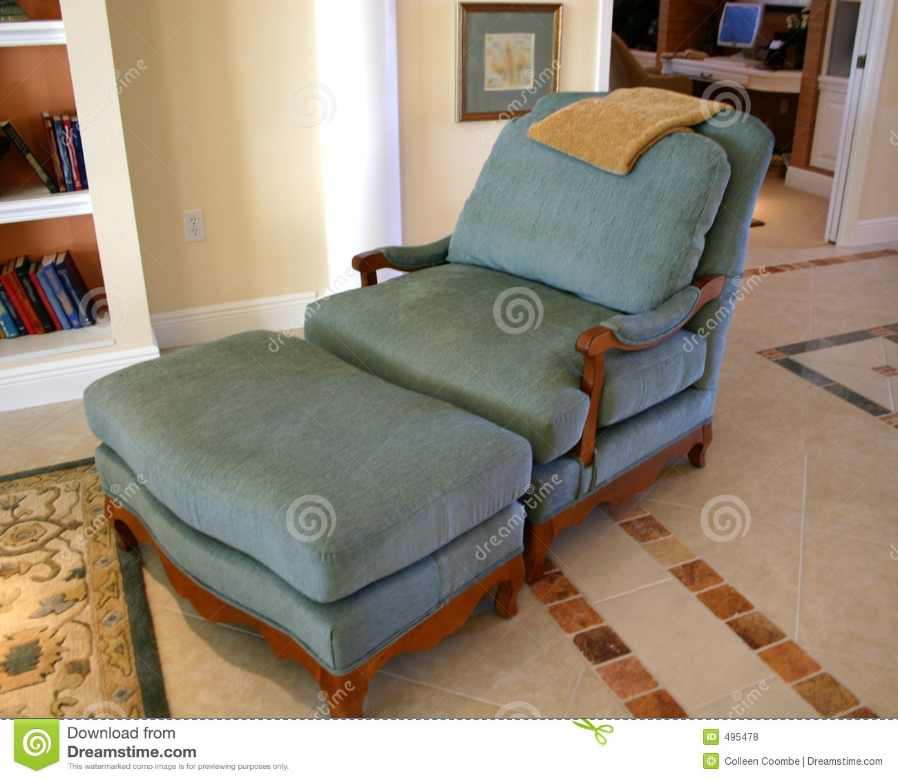 Comfortable blue lounge chair with ottoman on decorated tile mr no pr